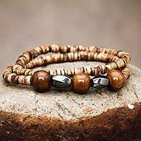 Beaded stretch bracelets, 'Homeland' (pair) - Two Handcrafted Ceramic Bead Stretch Bracelets from Peru