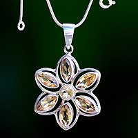 Citrine pendant necklace, 'Sunflower' - Silver and Citrine Floral Pendant Necklace