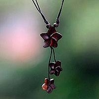 Wood pendant necklace, 'Stars for Hope' - Handcrafted Bali Wood and Cotton Star Theme Necklace