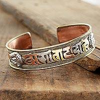 Copper cuff bracelet, 'Tibetan Mantra' - Tibetan Om Mantra Copper and Brass Cuff Bracelet