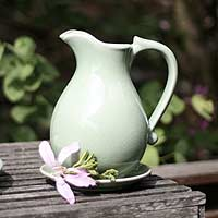 Celadon ceramic pitcher and plate,