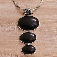 Onyx pendant necklace, 'Night Ovals' - Onyx and Sterling Silver Oval Pendant Necklace from Bali
