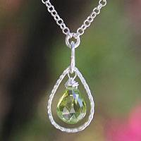 Peridot pendant necklace, 'Smile' - Hand Crafted Sterling Silver and Peridot Pendant Necklace