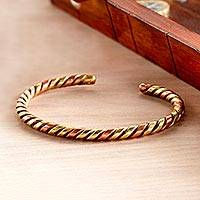Brass and copper bracelet, 'Twist and Gleam' - African Currency Copper Bracelet