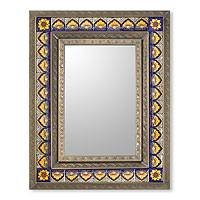 Tin and ceramic wall mirror,