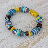 Pinewood and recycled paper beaded bracelet, 'Ocean Sun' - Colorful Pinewood and Recycled Paper Bracelet from Guatemala