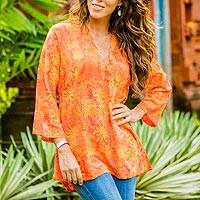 Rayon batik tunic, 'Daisy Cheer' - Handmade V-Neck Orange Floral Batik Rayon Tunic