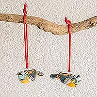 Ceramic ornaments, 'Seven Colors' (pair) - Handcrafted Pair of Ceramic Bird Ornaments