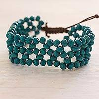 Wood beaded wristband bracelet, 'Divine Love' - Fair Trade Turquoise Wood Beaded Wristband Bracelet