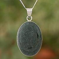 Reversible jade pendant necklace, 'Dark Green Tikal Toucan' (Guatemala)