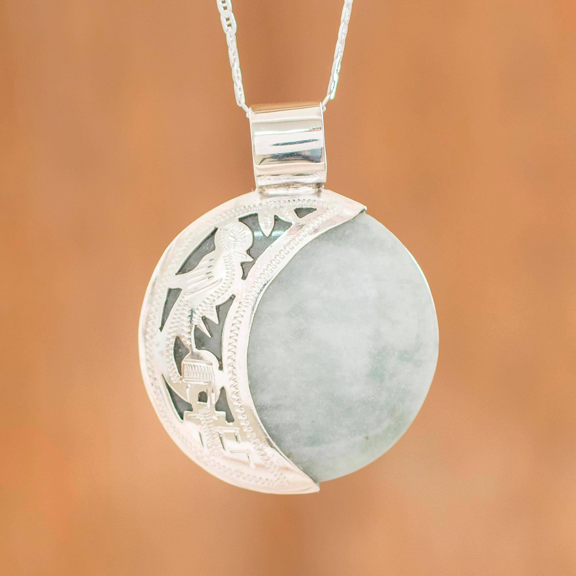 Unicef market reversible silver pendant necklace with 2 for Pictures of jade jewelry