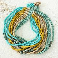 Beaded bracelet, 'Life is a Carnival Feast' - Handmade Fair Trade Beaded Bracelet in Aqua Yellow Cream and