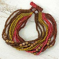 Beaded bracelet, 'Life is a Spring Feast' - Handmade Fair Trade Beaded Bracelet in Terracotta Pink Yello