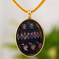 Brass and glass pendant necklace, 'Oval Birds of Toliman' - Brass and Faux Suede Pendant Necklace from Guatemala