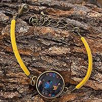 Brass and glass cord bracelet, 'Maya Birds of Toliman' - Yellow Cord Bracelet with Maya Bird Medallion