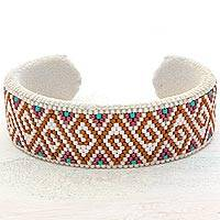Beaded cuff bracelet, 'Oasis of Color' - Glass Beaded Cuff Bracelet Spiral Motif from El Salvador