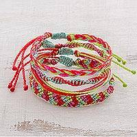 Braided bracelets, 'Watermelon' (set of 4) - Four Hand-Braided Colorful Bracelets from Guatemala