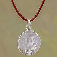 Fine silver pendant necklace, 'Shimmering Fingerprint' - Fine Silver and Leather Fingerprint Necklace from Guatemala