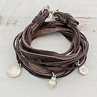 Fine silver and leather wrap bracelet, 'Stellar Imprint' - Leather Fine Silver Wrap Charm Bracelet from Guatemala