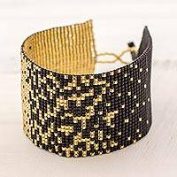 Beaded wristband bracelet, 'Midnight Soiree' - Wide Glass Beaded Bracelet in Black and Gold Guatemala