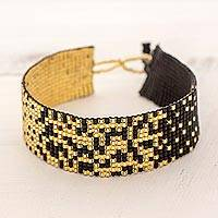 Beaded wristband bracelet, 'Midnight Sparkles' - Glass Beaded Bracelet in Black and Gold from Guatemala