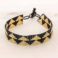 Beaded wristband bracelet, 'Golden Triangles' - Triangle Glass Beaded Bracelet in Black and Gold Guatemala