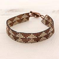 Beaded wristband bracelet, 'Mahogany Triangles' - Triangle Glass Wristband Bracelet in Brown from Guatemala