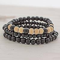 Wood beaded stretch bracelets, 'Black Force' (set of 3) - Beige and Black Wood Beaded Bracelets (Set of 3) Guatemala