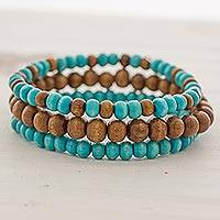 Wood beaded stretch bracelets, 'Blue Force' (set of 3) - Brown and Blue Wood Beaded Bracelets (Set of 3) Guatemala