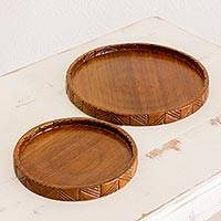 Wood trays, 'Natural Circles' (pair) - Hand Carved Conacaste Wood Trays (Pair) from Guatemala