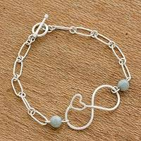 Jade pendant bracelet, 'Ancient Love' - Jade and Sterling Silver Pendant Bracelet from Guatemala