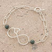 Jade pendant bracelet, 'Ancient Love in Green' - Guatemalan Jade and Sterling Silver Heart Infinity Bracelet