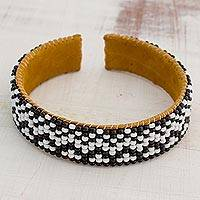 Glass beaded cuff bracelet, 'Snow White City' - Black and Snow White Glass Beaded Bracelet from Guatemala