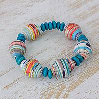 Wood and recycled paper beaded stretch bracelet, 'Sea Ridges' - Pinewood and Recycled Paper Bracelet in Blue from Guatemala
