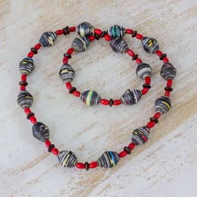 Pinewood and recycled paper beaded necklace, 'Earth Energy' - Pinewood and Recycled Paper Necklace in Red from Guatemala
