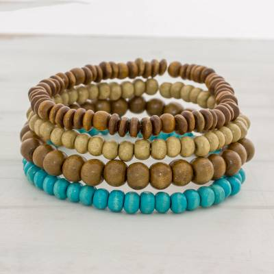 four brown and blue wood beaded bracelets from guatemala