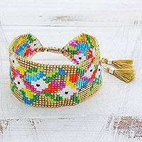 Glass beaded wristband bracelet, 'Delicate Garden' - Colorful Glass Beaded Wristband Bracelet from Guatemala