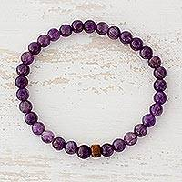 Amethyst beaded stretch bracelet, 'Rain of Purple' - Amethyst and Pinewood Beaded Stretch Bracelet from Guatemala