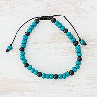 Wood beaded bracelet, 'Turquoise Hummingbird' - Pinewood Beaded Bracelet in Turquoise from Guatemala
