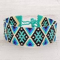 Beaded wristband bracelet, 'Sea Stars' - Blue and Black Geometric Beaded Wristband Bracelet