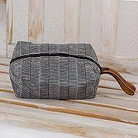 Cotton cosmetic bag, 'Cosmopolitan' - Black and White Striped Hand Woven Cotton Cosmetic Bag