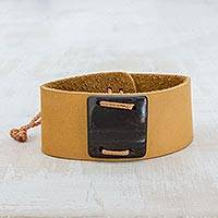 Leather wristband bracelet, 'Energetic' - Mustard Leather Coconut Shell Pendant Wristband Bracelet