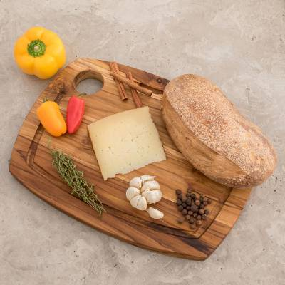 Teakwood cutting board, 'Gorgeous Grain' - Sustainably Harvested Teakwood Grooved Rim Cutting Board