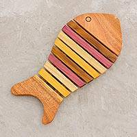 Wood trivet, 'Striped Swimmer' - Yellow and Red Wood Fish-Shaped Trivet