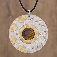 Tiger's eye pendant necklace, 'Shining Suns' - Modern Tiger's Eye and Brass Circle Pendant Necklace