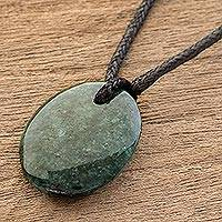 Jade pendant necklace, 'Ancient Strength' - Green Jade Pendant Necklace with Cotton Cord