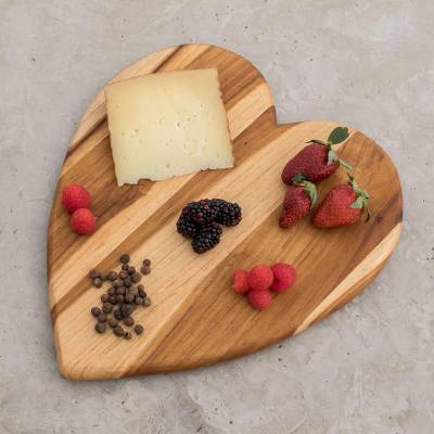 Teakwood cutting board, 'Heart of Cooking' - Heart-Shaped Teakwood Cutting Board from Guatemala