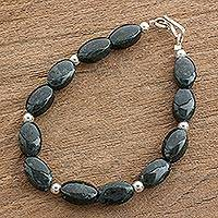 Jade beaded bracelet, 'Dark Green Ovals' - Dark Green Oval Jade Beaded Bracelet from Guatemala