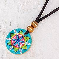 Wood pendant necklace, 'Vibrant Seed in Blue' - Floral Pinewood Pendant Necklace in Blue from Guatemala