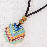 Wood pendant necklace, 'Mayan Evolution' - Hand-Painted Pinewood Pendant Necklace from Guatemala